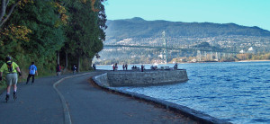 Seawall Vancouver with Lions Gate Bridge in the background.